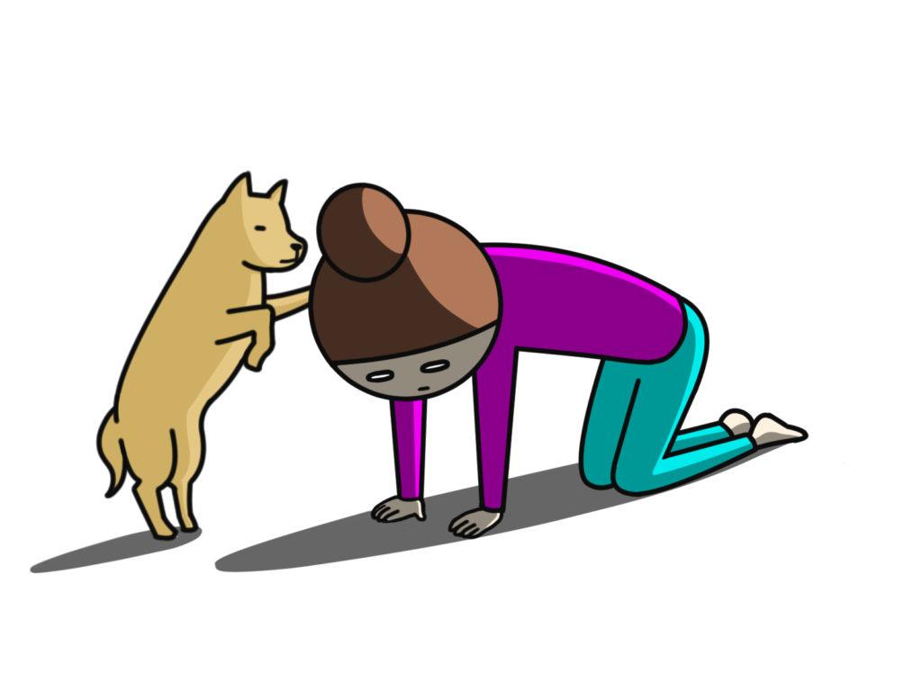 悲しんでいる女の子を子犬が慰めている